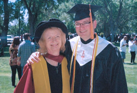 Dr. Gillian Bond and her son at his commencement ceremony.