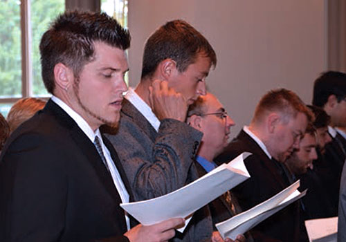 McGinley (left) sings at the Opening Service 2012.