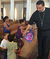 Arturo Méndez distributes school supplies at Trinity Lutheran Church, Houston, Texas as part of a student outreach program.