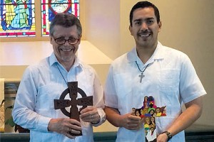 Left: Juan Vallejo with a cross carved by his  grandfather. Above: Prof. Mark Kempff, CHS  instructor and assistant to the CHS director (left), keeps a cross made by Vallejo's grandfather for his father, Rev Gerhard Kempff, in his office as a reminder of his heritage and those who came before him.