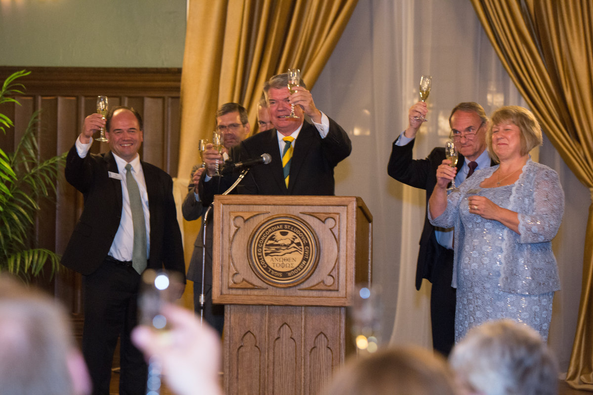 Seminary President Dr. Dale A. Meyer, center, raises a toast as he announces the public phase of the Generations Campaign on Sept. 25 during a gala in Koburg Hall.