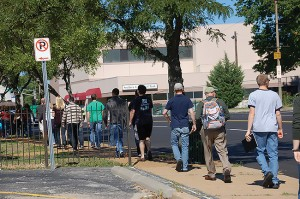 Participants in the MissionShift Institute trek through different parts of St. Louis on a tour of ministries in the metro area, Sept. 13, 2014.