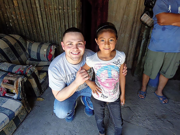 Master of Divinity student Ryan Schnake with Angela, a child he sponsors  in Guatemala. He took a mission trip to Central America during his first year  at Concordia Seminary in 2014-15. Photo: Ryan Schnake