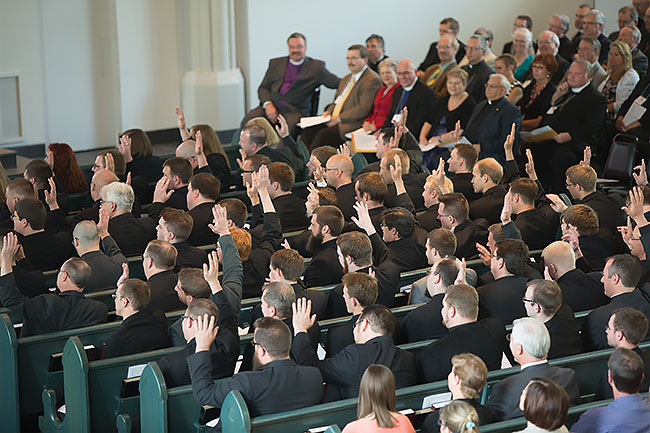Second-year students raise their hands in response to a question during the vicarage  assignment service, April 29, 2015, in the Chapel of St. Timothy and St. Titus.