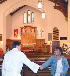 Vicar James Kirschenmann shares God's peace with parishioners at a Sunday service in November 2015 at St. Paul's Lutheran Church—College Hill, St. Louis. Photo: Melanie Ave