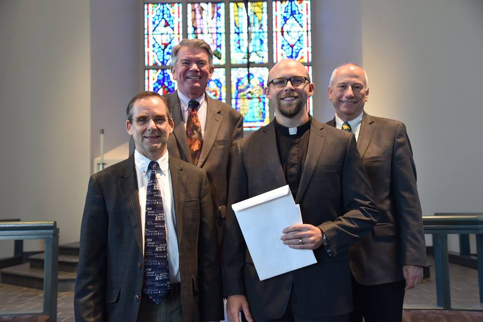 James Prothro, center, received a call to Trinity Lutheran Church in Park Hills, Mo. Also pictured, from left: Dr. Rick Marrs, director of the Master of Divinity and Residential Alternate Route Programs; Seminary President Dr. Dale A. Meyer; and Dr. Wallace Becker, director of placement.