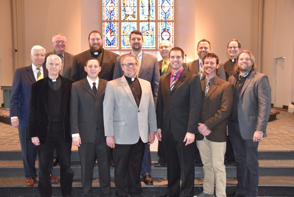 Front row, from left: Director of Vicarage and Deaconess Internships Dr. Glenn Nielsen, Matthew Cario, Craig McCourt, Jason Schleicher, Jacob Baumann and Mark Crossman. Back row, from left: SMP Director Dr. Andrew Bartelt, President Dr. Dale A. Meyer, Cory Stallings, Chad Minor, Laird Van Gorder, Joel Dietrich and SMP Director Dr. W. Mart Thompson. Not pictured: Wynn Derong and Muluneh Taye.