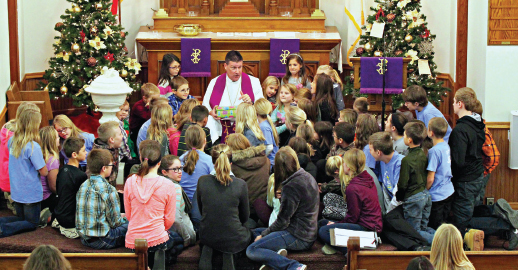 Rev. Brad Birtell leads a children's message at St. John Lutheran Church in Columbus, Neb., in December 2016. Photo: Red Willow Photography