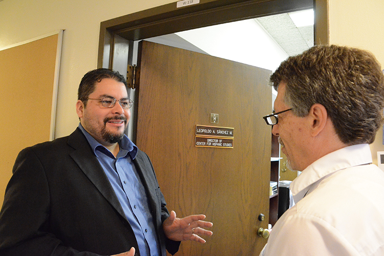 Professor Leopoldo A. Sánchez M., left, chats with Mark Kempff, assistant to the director of the Center for Hispanic Studies.